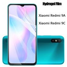 Гидрогелевая защитная плёнка для смартфона Xiaomi Redmi 9A / Xiaomi Redmi 9C, в комплект входят 2 плёнки, глянцевая плёнка, матовая плёнка, бронированная плёнка, полноэкранная плёнка (закрывает экран смартфона полностью), клеится к экрану смартфона всей поверхностью, клеится без использования жидкости, не влияет на чувствительность сенсора, не искажает цвета, олеофобное покрытие, пластиковый держатель для точного позиционирования плёнки на экране, шпатель для разглаживания плёнки, Киев